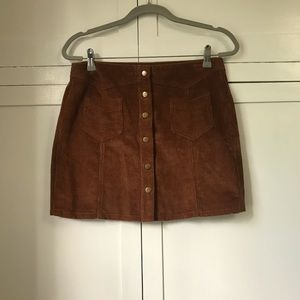 Tan corduroy mini skirt with button front
